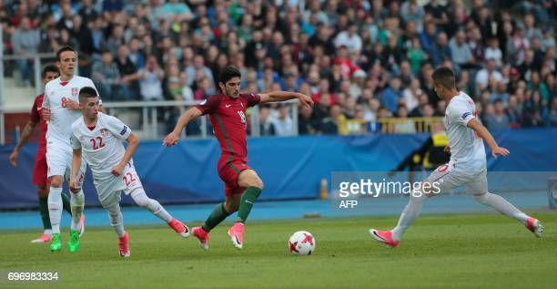Serbia's midfielders Mijat Gacinovic and Portugal's forward Goncalo Guedes vie for the ball during the UEFA U21 European Championship Group B...