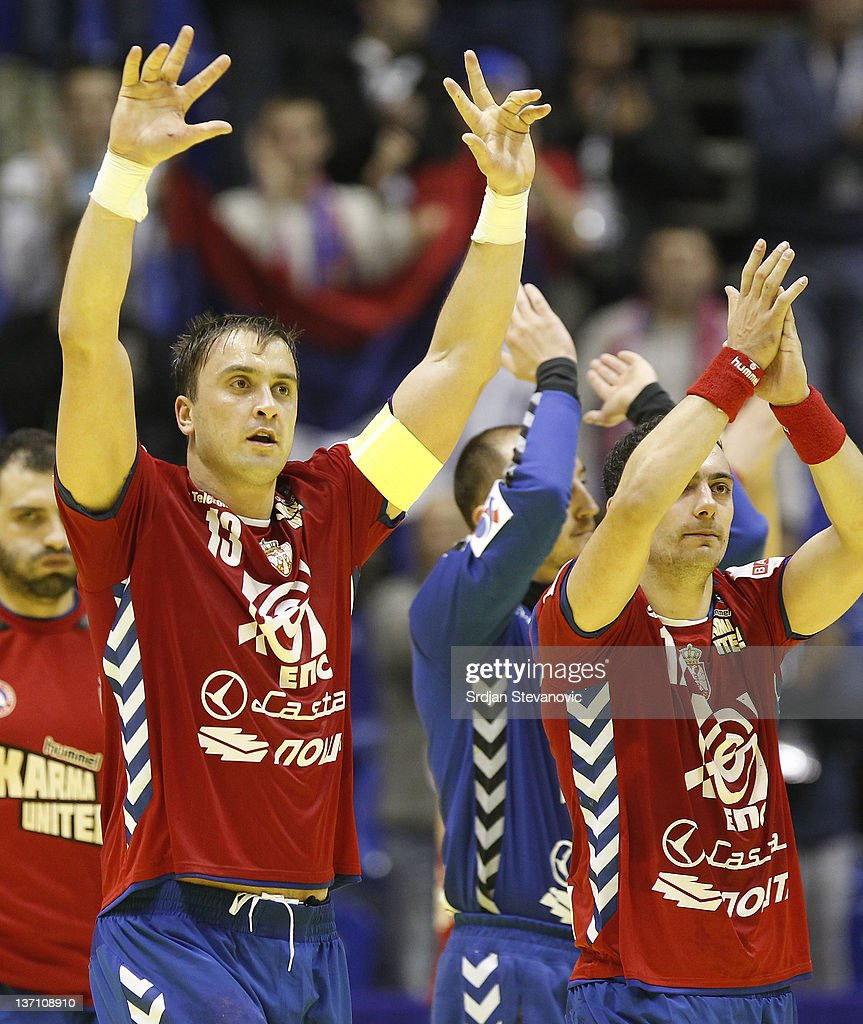 Serbia's Momir Ilic (L), celebrate victory over Poland during the Men's European Handball Championship group A match between Poland and Serbia at Pionir Sports Centre on January 15, 2011 in Belgrade, Serbia.