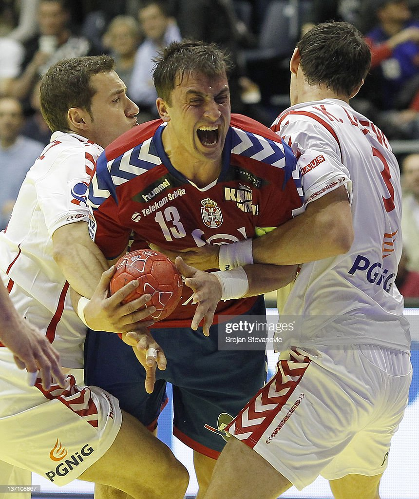 Serbia's <a gi-track='captionPersonalityLinkClicked' href=/galleries/search?phrase=Momir+Ilic&family=editorial&specificpeople=857763 ng-click='$event.stopPropagation()'>Momir Ilic</a> in action against Poland <a gi-track='captionPersonalityLinkClicked' href=/galleries/search?phrase=Krzysztof+Lijewski&family=editorial&specificpeople=842972 ng-click='$event.stopPropagation()'>Krzysztof Lijewski</a> (R) during the Men's European Handball Championship group A match between Poland and Serbia at Pionir Sports Centre on January 15, 2011 in Belgrade, Serbia.