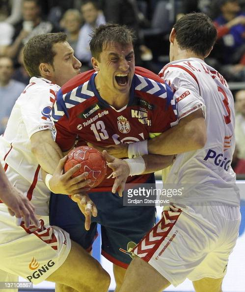 Serbia's Momir Ilic in action against Poland Krzysztof Lijewski during the Men's European Handball Championship group A match between Poland and...