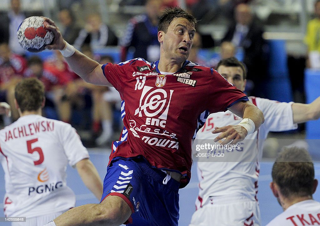 Serbia's Momir Ilic jumps with the ball during the handball pre-Olympic qualifying match Serbia vs Poland on April 7, 2012 at the Tecnificacion Center sports hall in Alicante. The match ended in a 25-25 draw.