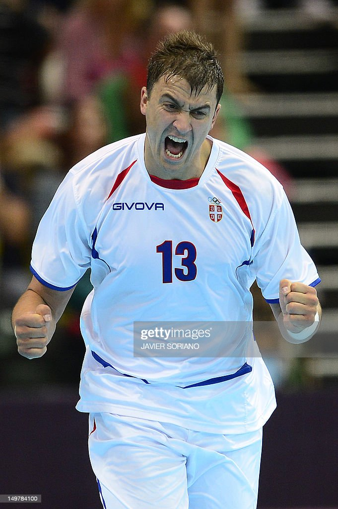 Serbia's Momir Ilic reacts after a goal during the men's preliminary Group B handball match South Korea vs Serbia for the London 2012 Olympics Games on August 4, 2012 at the Copper Box hall in London.