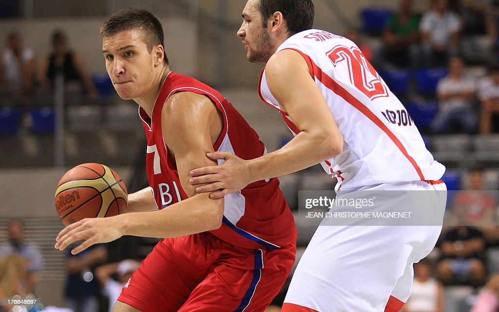 Serbia's national basketball team player Bogdan Bogdanovic (L) vies with Georgia's national basketball player Nikoloz Tskitishvili during the friendly basketball match between Serbia and Georgia, on August 16, 2013, in Antibes, southeastern France, as part of the preparation for the 2013 EuroBasket in Slovenia.
