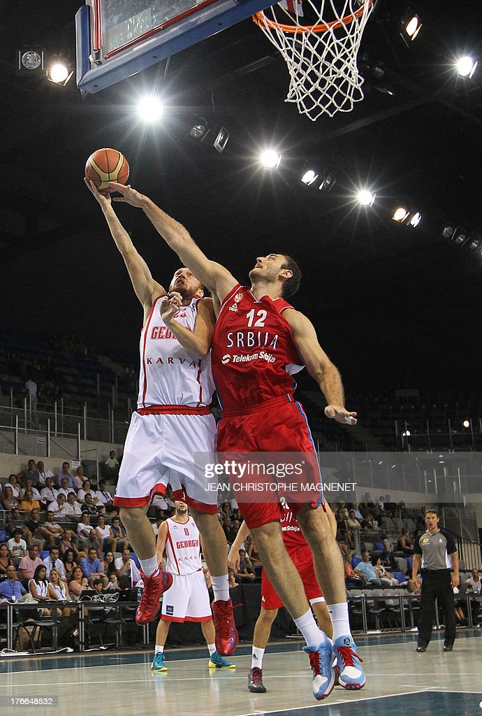 Serbia's national basketball team player Nenad Krstic (R) vies with Georgia's national basketball team player Besik Lezhava (L) during the friendly basketball match between Serbia and Georgia, on August 16, 2013, in Antibes, southeastern France, as part of the preparation for the 2013 EuroBasket in Slovenia. AFP PHOTO / JEAN CHRISTOPHE MAGNENET