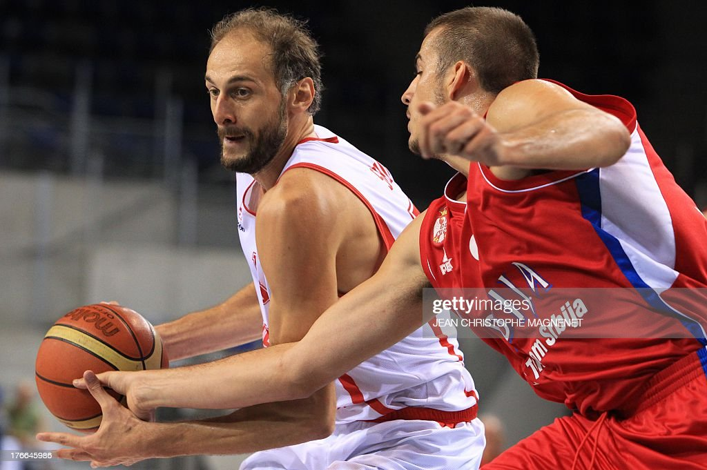Serbia's Nemanja Bjelica (R) challenges Georgia's Viktor Sanikidze (L) during a friendly basketball match between Serbia and Georgia on August 16, 2013 in Antibes, southeastern France as part of the preparation for the 2013 EuroBasket in Slovenia.