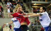 Serbia's Nenad Vuckovic and Alem Toskic attempt to stop Norway's Erlend Mamelund during their Group D Men's Handball World Championship match on...