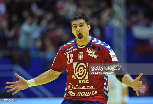 Serbia's Nenad Vuckovic reacts after scoring against Poland during the 10th EHF 2012 European Men's Handball Championship match on January 15 at the...