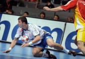 Serbia's Nenad Vuckovic vies with Macedonia's Kiril Lazarov during their World Handball Championship match in Zadar on January 27 2009 AFP...