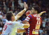 Serbia's Nenad Vuckovic vies with Poland's Zbigniew Kwiatkowski during their 10th EHF European 2012 Men's Handball Championship match at the Pionir...