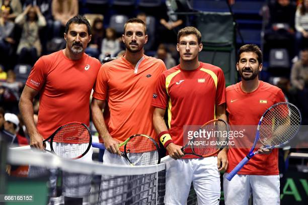 Serbia's Nenad Zimonjic and Viktor Troicki and Spain's Pablo Carreno Busta and Marc Lopez pose ahead of the Davis Cup quarterfinal tennis double...