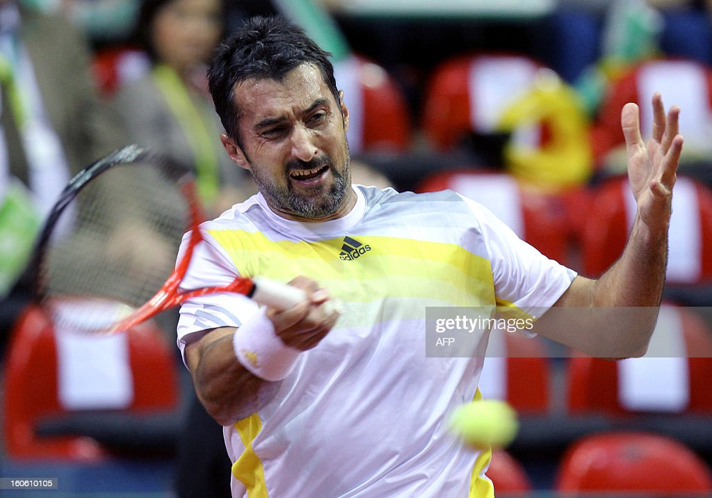 Serbia's Nenad Zimonjic returns the ball to Belgian Steve Darcis during the Davis Cup tennis match between Belgium and Serbia on February 3, 2013 in Charleroi. LEFOUR -Belgium Out-