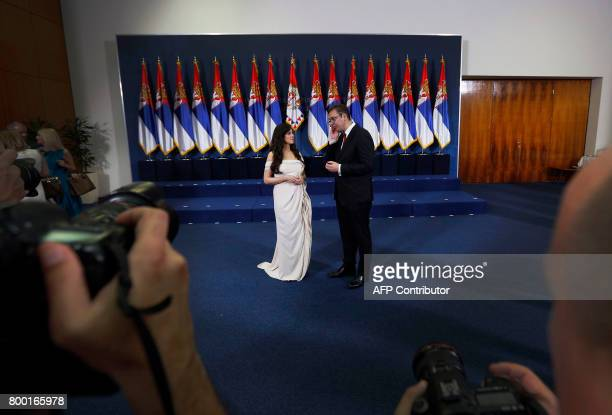 Serbia's new president Aleksandar Vucic Aleksandar Vucic and his wife Tamara pose for photographers during the formal swearingin ceremony in Belgrade...