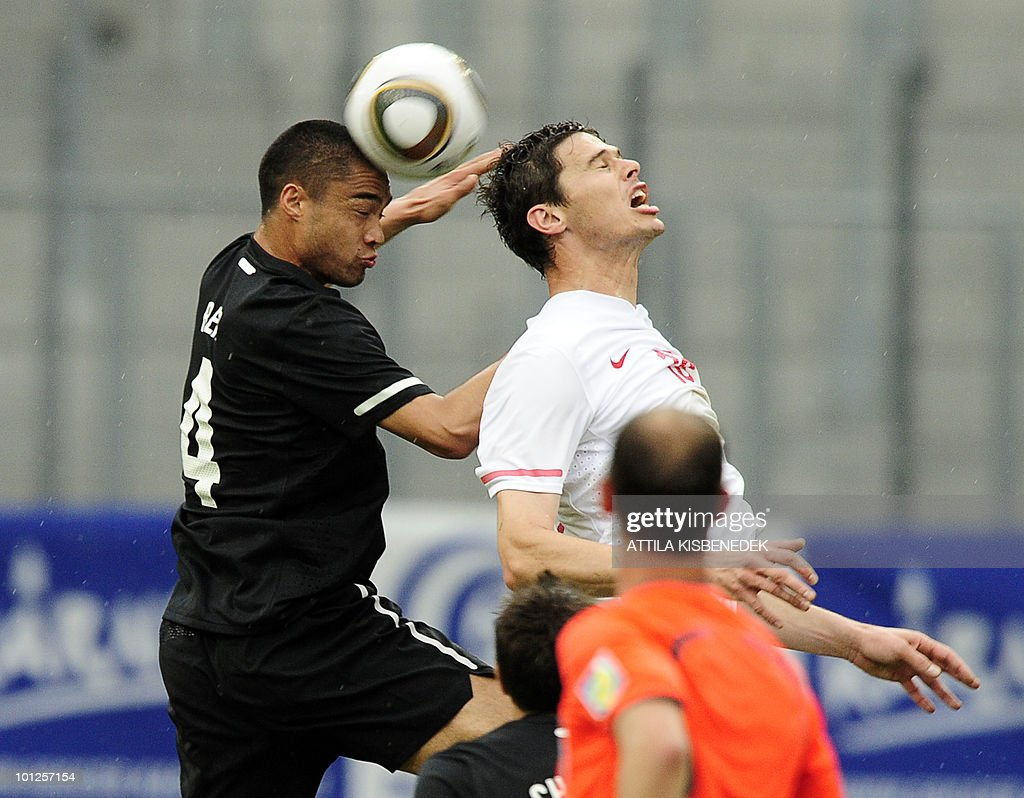 Serbia's Nikola Zigic (R) heads the ball with New-Zealand's Winstin Reid (L) during their friendly match between their teams in the Hypo Arena Wörthersee Stadium of Klagenfurt on May 29, 2010 prior to the FIFA World Cup 2010 hosted by South Africa between June 11 and July 11.