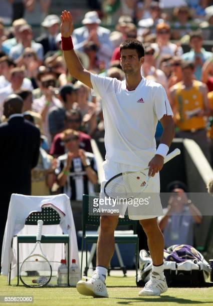Serbia's Novak Djokovic acknowledges the crowd after beating Germany's Simon Greul at the 2009 Wimbledon Championships at the All England Lawn Tennis...