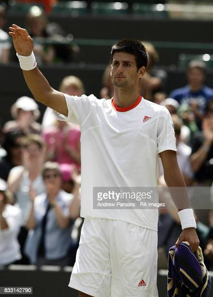 Serbia's Novak Djokovic acknowledges the crowd after conceding his semifinal match against Spain's Rafael Nadal during The All England Lawn Tennis...