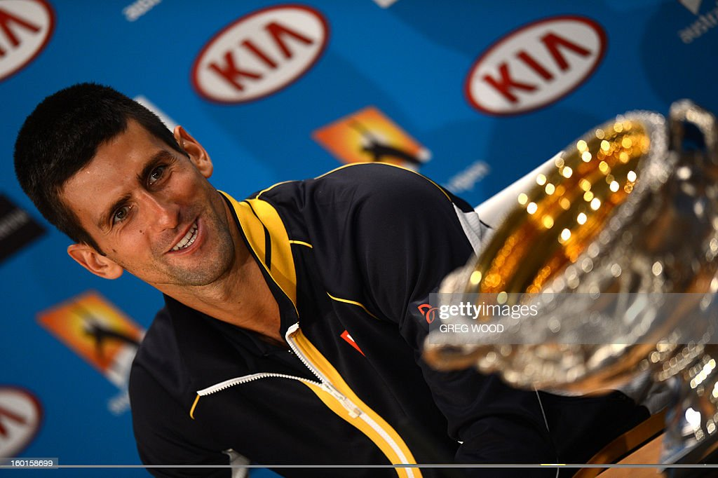 Serbia's Novak Djokovic addresses a press conference after victory in his men's singles final against Britain's Andy Murray on day fourteen of the Australian Open tennis tournament in Melbourne early on January 28, 2013.