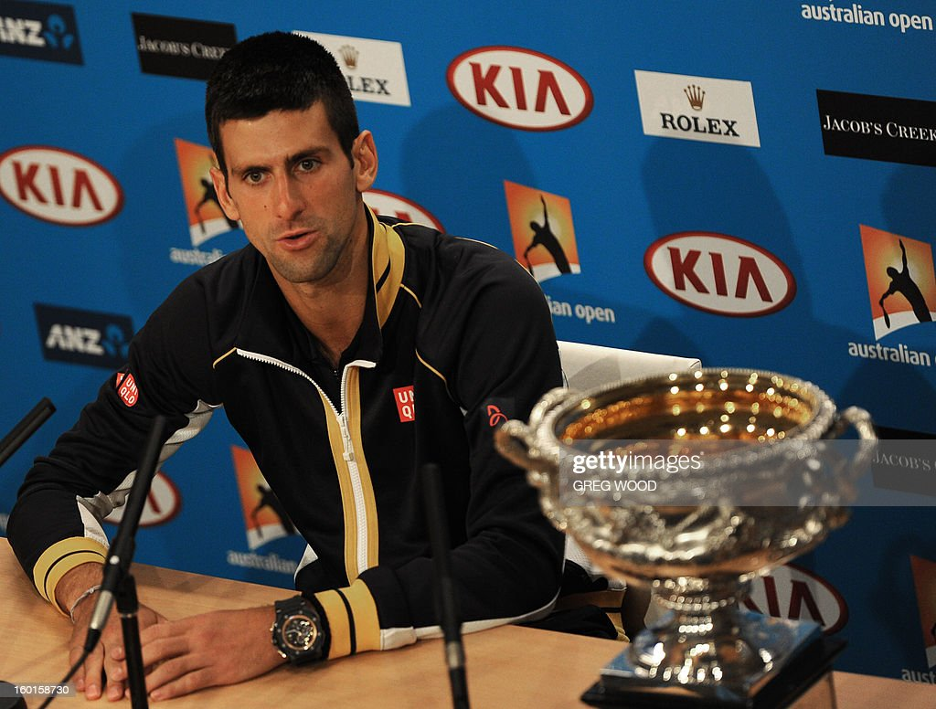 Serbia's Novak Djokovic addresses a press conference after victory in his men's singles final against Britain's Andy Murray on day fourteen of the Australian Open tennis tournament in Melbourne early on January 28, 2013. AFP PHOTO/GREG WOOD IMAGE STRICTLY RESTRICTED TO EDITORIAL USE - STRICTLY NO COMMERCIAL USE
