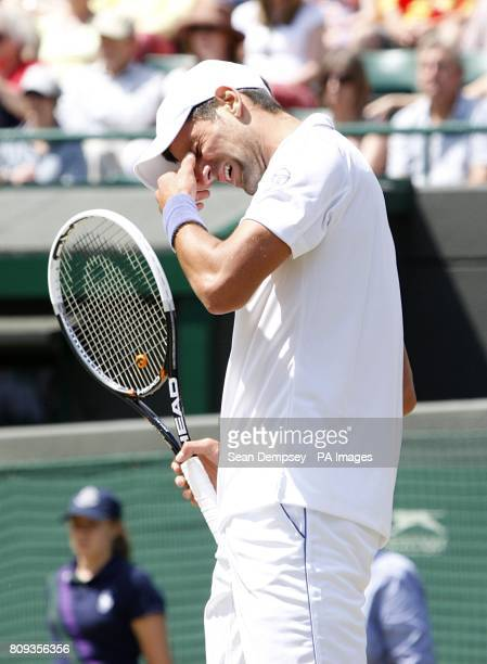 Serbia's Novak Djokovic appears dejected in his quarterfinal match against Australia's Bernard Tomic