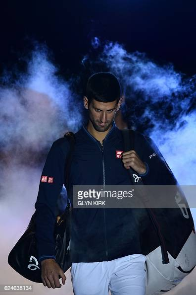 Serbia's Novak Djokovic arrives on court to play against Britain's Andy Murray during the men's singles final on the eighth and final day of the ATP...