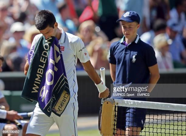 Serbia's Novak Djokovic bites down on his towel during his match against Bulgaria's Grigor Dimitrov