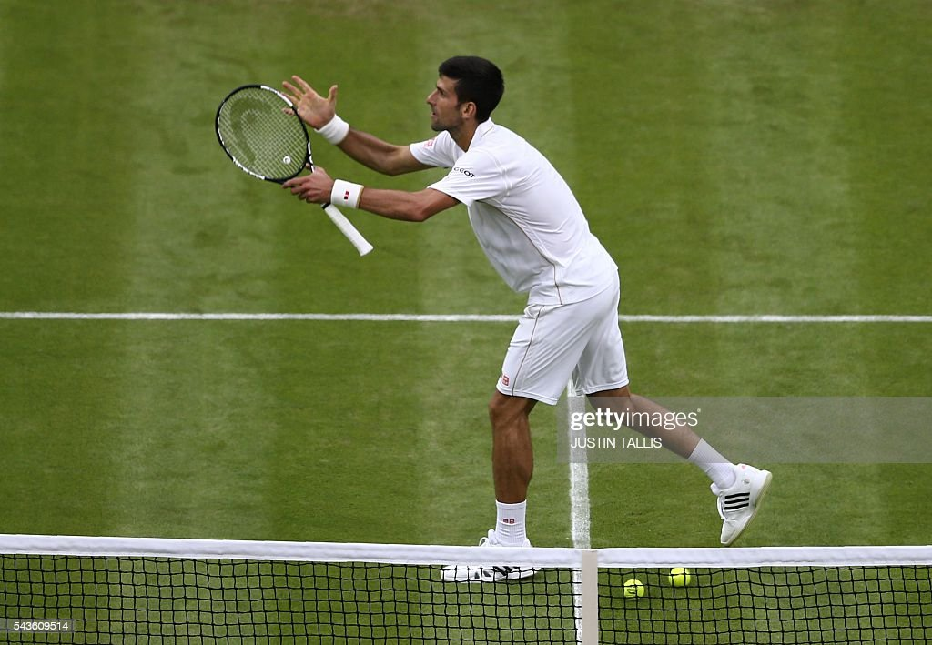 Serbia's Novak Djokovic celebrates after beating France's Adrian Mannarino in their men's singles second round match on the third day of the 2016 Wimbledon Championships at The All England Lawn Tennis Club in Wimbledon, southwest London, on June 29, 2016. / AFP / JUSTIN