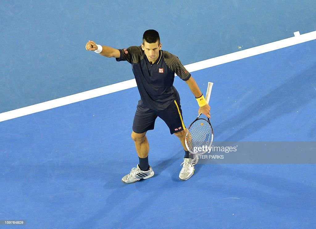 Serbia's Novak Djokovic celebrates after beating Switzerland's Stanislas Wawrinka during their men's singles match on day seven of the Australian Open tennis tournament in Melbourne early on January 21, 2013. AFP PHOTO / PETER PARKS IMAGE STRICTLY RESTRICTED TO EDITORIAL USE - STRICTLY NO COMMERCIAL USE
