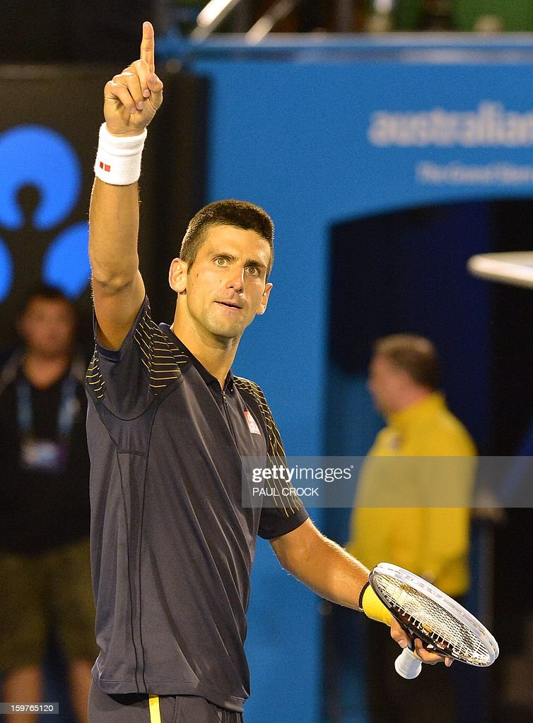 Serbia's Novak Djokovic celebrates after beating Switzerland's Stanislas Wawrinka during their men's singles match on day seven of the Australian Open tennis tournament in Melbourne early on January 21, 2013.