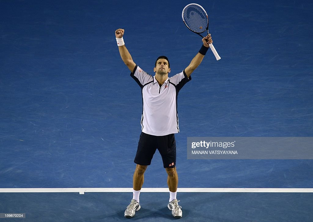 Serbia's Novak Djokovic celebrates after beating the Czech Republic's Tomas Berdych during their men's singles match on day nine of the Australian Open tennis tournament in Melbourne on January 22, 2013.