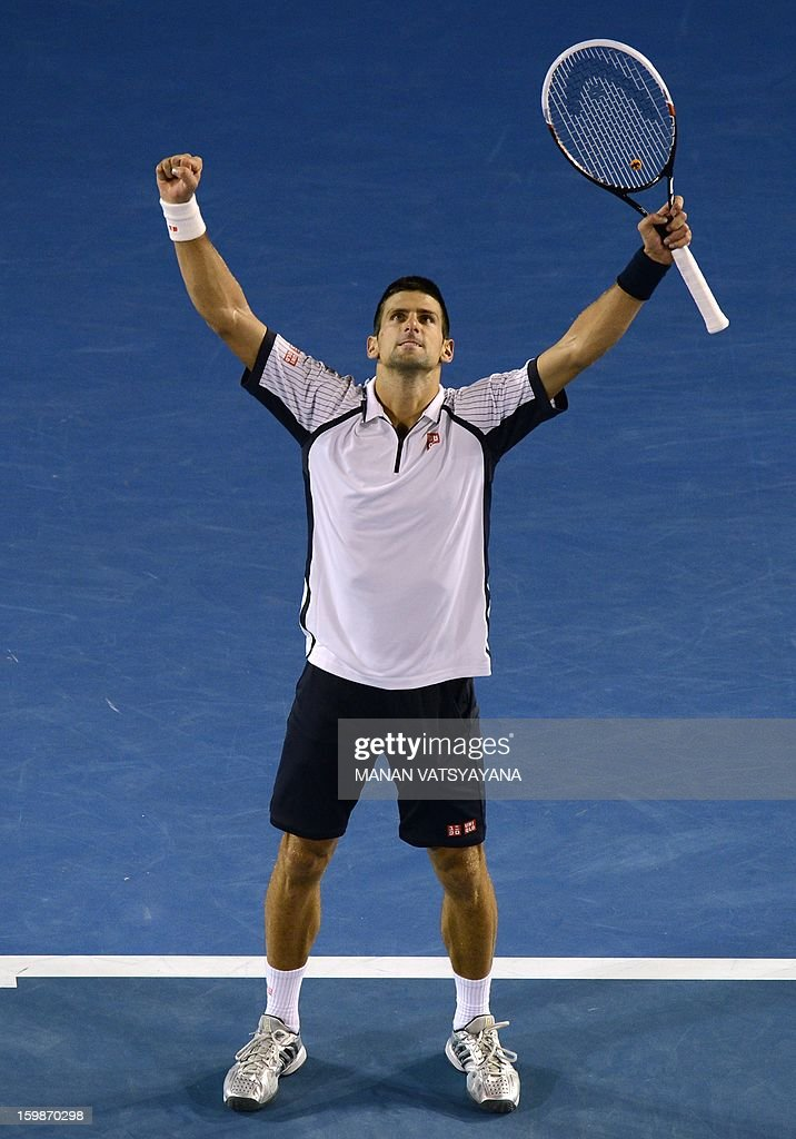 Serbia's Novak Djokovic celebrates after beating the Czech Republic's Tomas Berdych during their men's singles match on day nine of the Australian Open tennis tournament in Melbourne on January 22, 2013. AFP PHOTO / MANAN VATSYAYANA IMAGE STRICTLY RESTRICTED TO EDITORIAL USE - STRICTLY NO COMMERCIAL USE