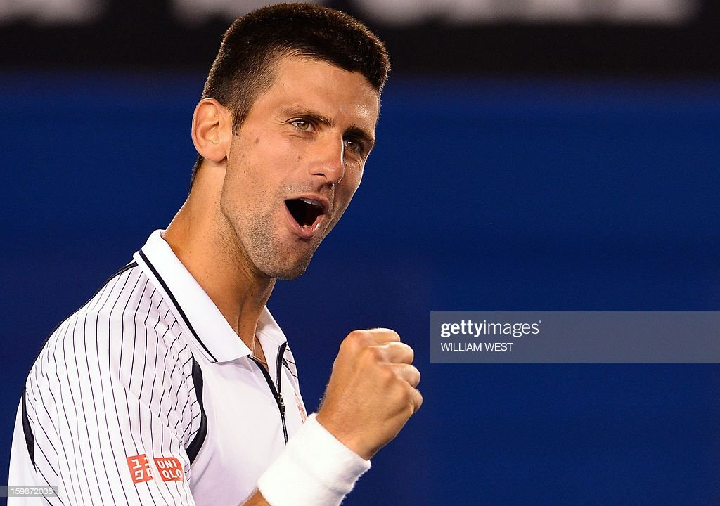 Serbia's Novak Djokovic celebrates after his victory against the Czech Republic's Tomas Berdych during their men's singles match on day nine of the Australian Open tennis tournament in Melbourne on January 22, 2013.