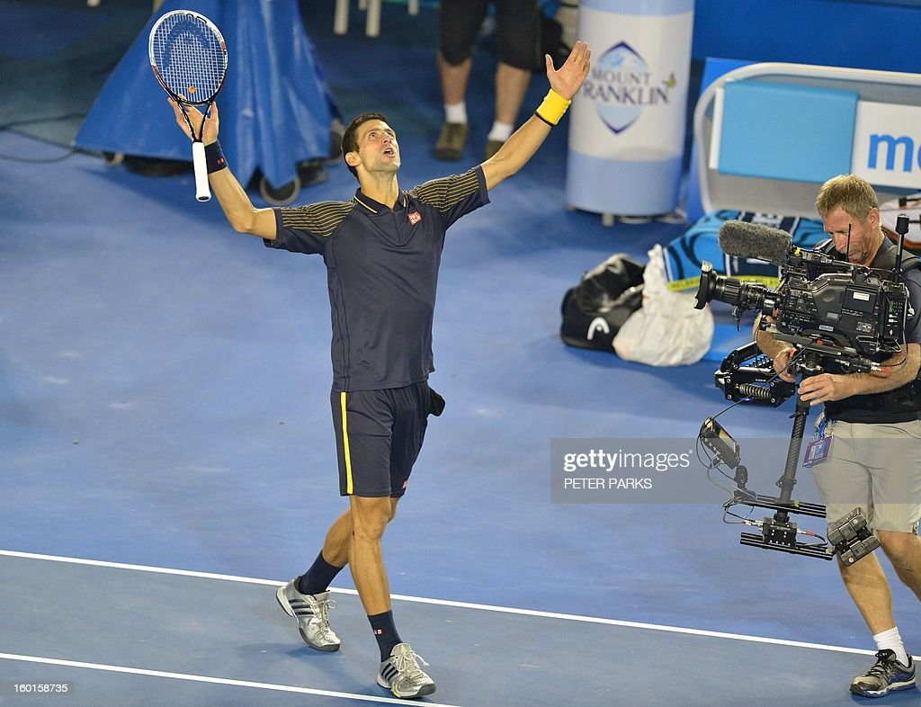 Serbia's Novak Djokovic celebrates after his victory over Britain's Andy Murray during the men's singles final on day 14 of the Australian Open tennis tournament in Melbourne on January 27, 2013. AFP PHOTO / PETER PARKS IMAGE STRICTLY RESTRICTED TO EDITORIAL USE - STRICTLY NO COMMERCIAL USE