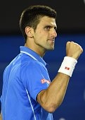 Serbia's Novak Djokovic celebrates after victory against Canada's Milos Raonic during their men's singles match on day ten of the 2015 Australian...