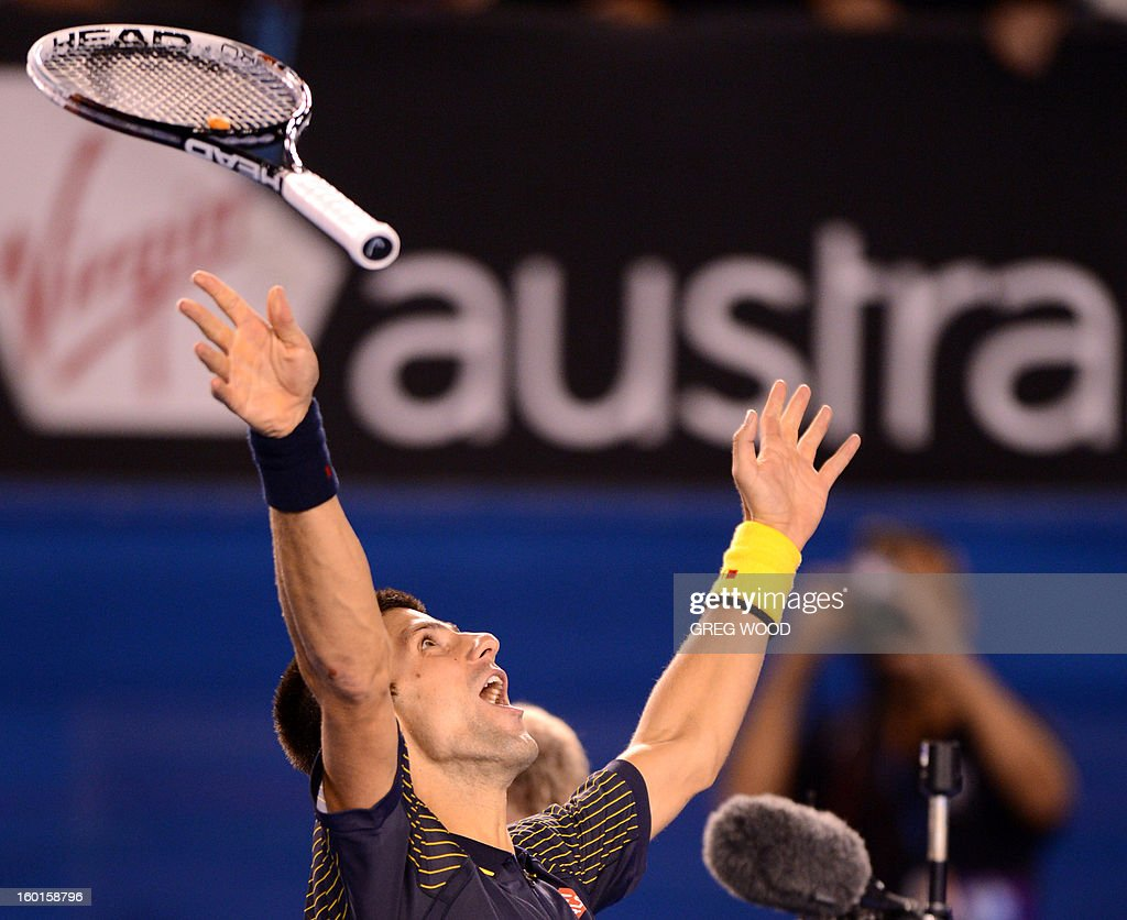 Serbia's Novak Djokovic celebrates after victory in his men's singles final against Britain's Andy Murray on day fourteen of the Australian Open tennis tournament in Melbourne on January 27, 2013. AFP PHOTO/GREG WOOD IMAGE STRICTLY RESTRICTED TO EDITORIAL USE - STRICTLY NO COMMERCIAL USE