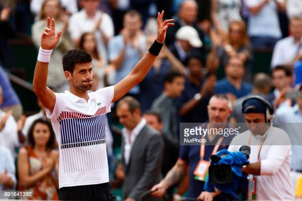 Serbia's Novak Djokovic celebrates after winning against Argentina's Diego Schwartzman during their tennis match at the Roland Garros 2017 French...