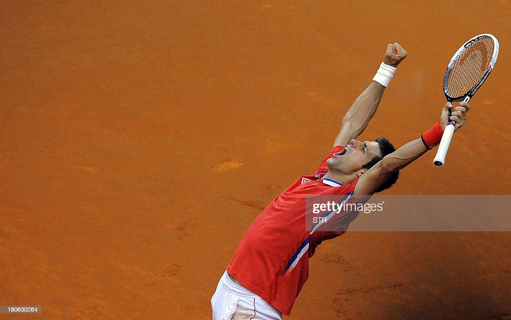 Serbia's Novak Djokovic celebrates after winning against Canada's Milos Raonic during their Davis Cup semi-final match at Belgrade Arena on September 15, 2013.