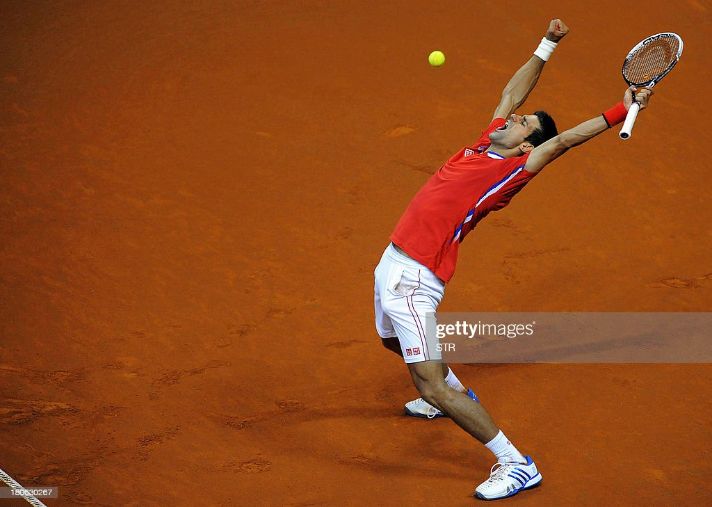 Serbia's Novak Djokovic celebrates after winning against Canada's Milos Raonic during their Davis Cup semi-final match at Belgrade Arena on September 15, 2013.