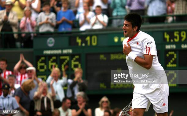 Serbia's Novak Djokovic celebrates after winning against Cyprus' Marcos Baghdatis during The All England Lawn Tennis Championship at Wimbledon