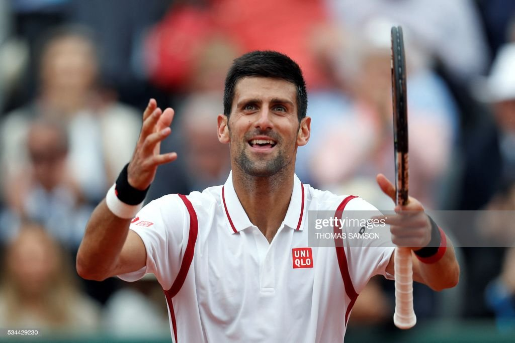 Serbia's Novak Djokovic celebrates after winning during his men's second round match against Belgium's Steve Darcis at the Roland Garros 2016 French Tennis Open in Paris on May 26, 2016. / AFP / Thomas SAMSON