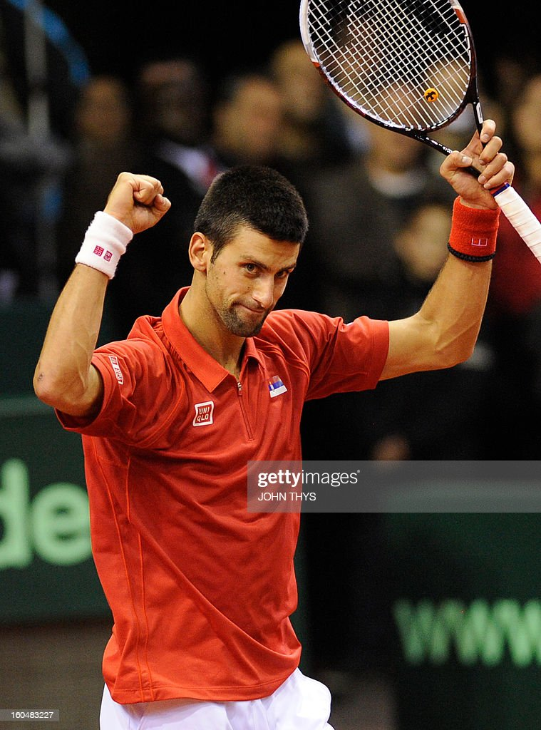 Serbia's Novak Djokovic celebrates after winning his Davis Cup World Group first round tennis match against Belgium's Olivier Rochus on February 1, 2013 in Charleroi.