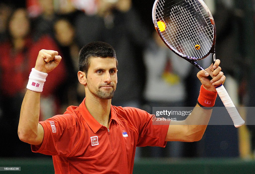 Serbia's Novak Djokovic celebrates after winning his Davis Cup World Group first round tennis match against Belgium's Olivier Rochus on February 1, 2013 in Charleroi. AFP PHOTO /JOHN THYS