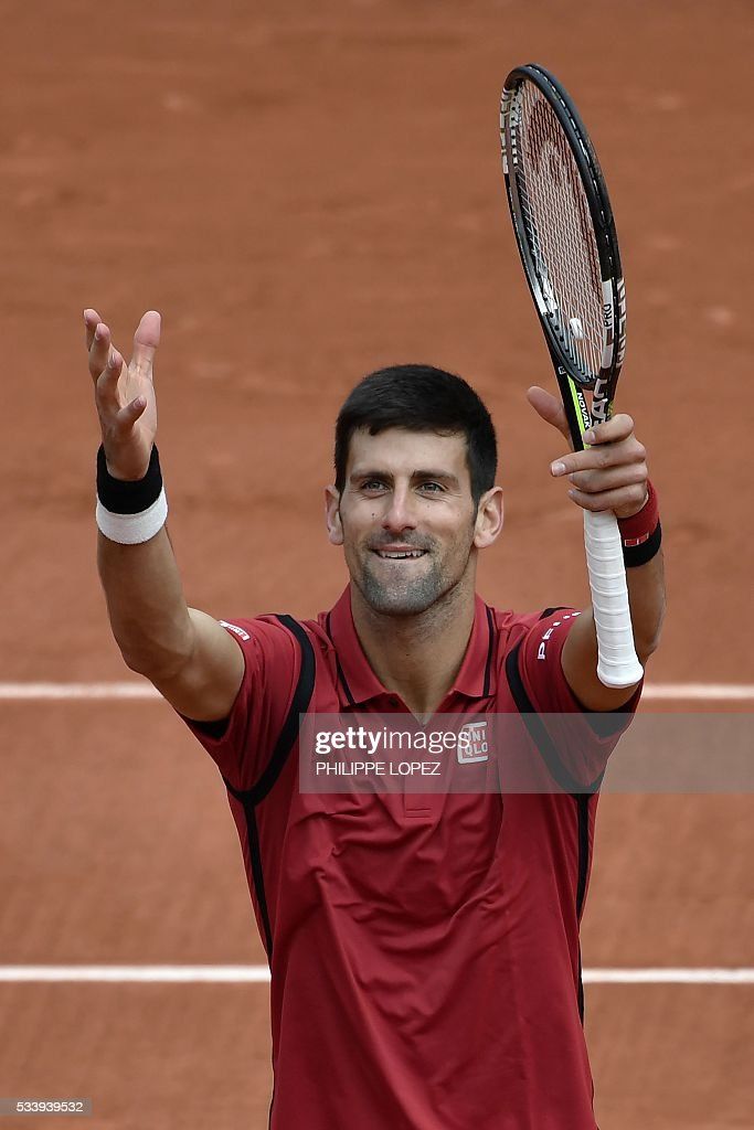 Serbia's Novak Djokovic celebrates after winning his men's first round match against Taiwan's Lu Yen-Hsun at the Roland Garros 2016 French Tennis Open in Paris on May 24, 2016. / AFP / PHILIPPE