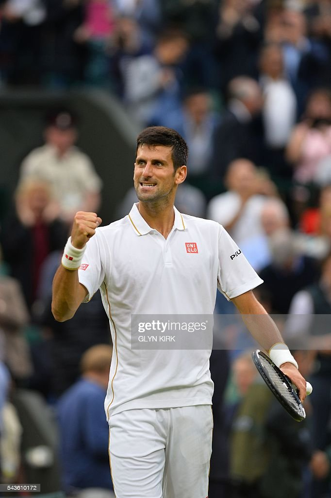 Serbia's Novak Djokovic celebrates beating France's Adrian Mannarino in their men's singles second round match on the third day of the 2016 Wimbledon Championships at The All England Lawn Tennis Club in Wimbledon, southwest London, on June 29, 2016. / AFP / GLYN