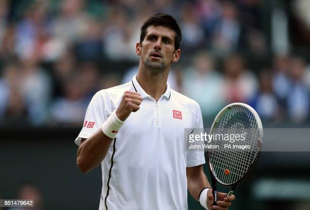 Serbia's Novak Djokovic celebrates beating Germany's Tommy Haas during day seven of the Wimbledon Championships at The All England Lawn Tennis and...