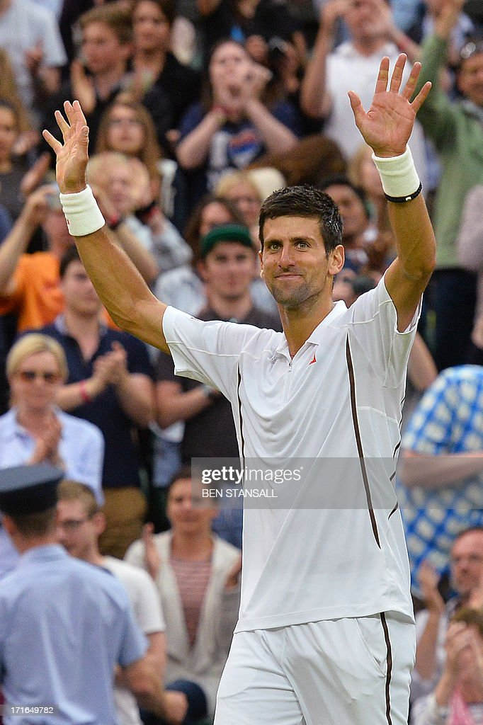 Serbia's Novak Djokovic celebrates beating US player Bobby Reynolds during their second round men's singles match on day four of the 2013 Wimbledon Championships tennis tournament at the All England Club in Wimbledon, southwest London, on June 27, 2013. Djokovic won 7-6, 6-3, 6-1. AFP PHOTO / BEN STANSALL - RESTRICTED TO EDITORIAL USE