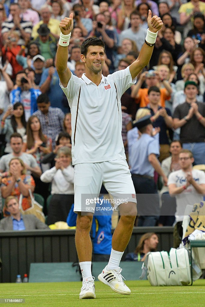 Serbia's Novak Djokovic celebrates beating US player Bobby Reynolds during their second round men's singles match on day four of the 2013 Wimbledon Championships tennis tournament at the All England Club in Wimbledon, southwest London, on June 27, 2013. Djokovic won 7-6, 6-3, 6-1.