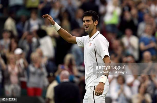 Serbia's Novak Djokovic celebrates beating USA's Bobby Reynolds during day four of the Wimbledon Championships at The All England Lawn Tennis and...