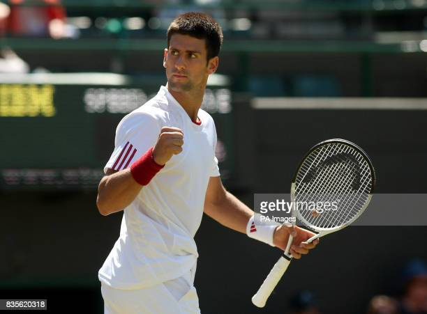 Serbia's Novak Djokovic celebrates during his match against Germany's Simon Greul during the 2009 Wimbledon Championships at the All England Lawn...
