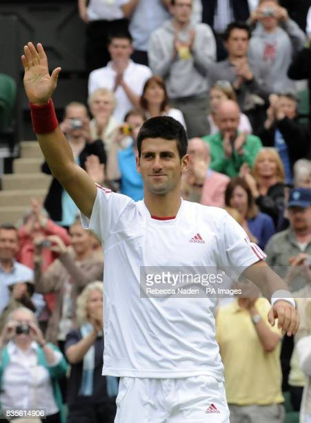 Serbia's Novak Djokovic celebrates his victory during the 2009 Wimbledon Championships at the All England Lawn Tennis and Croquet Club Wimbledon...