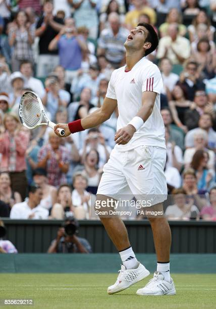 Serbia's Novak Djokovic celebrates winning his match against USA's Mardy Fish during the Wimbledon Championships 2009 at the All England Tennis Club