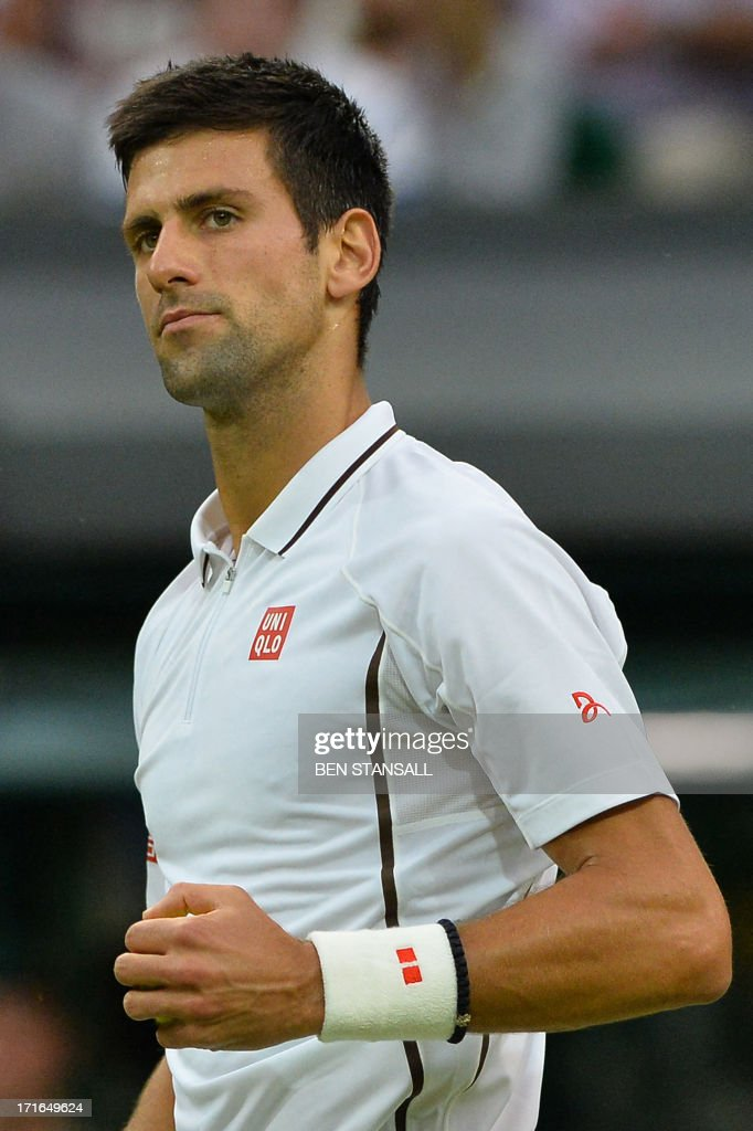 Serbia's Novak Djokovic celebrates winning the first set against US player Bobby Reynolds during their second round men's singles match on day four of the 2013 Wimbledon Championships tennis tournament at the All England Club in Wimbledon, southwest London, on June 27, 2013.